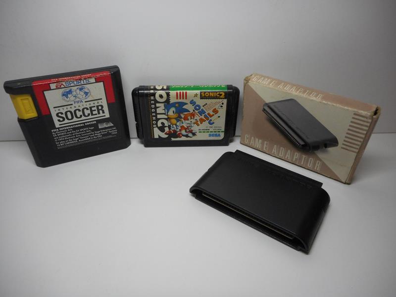 Sega Mega Drive II + Game Adaptor + 2 Control Pad + 2 Games